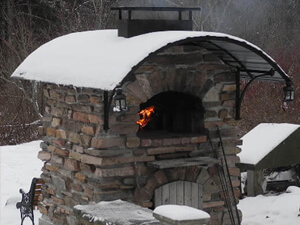 Outdoor brick pizza oven in the snow