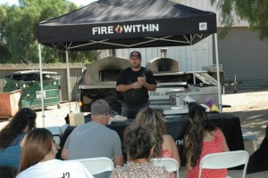 Vito Romani, sharing his journey with the crowd before serving them his superb pizzas.