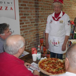 Norma, presenting her pepperoni pizza to the judges (Pete LaChappelle on the left, Peter Reinhart in the center, John Arena on the right, at the Caputo Cup.