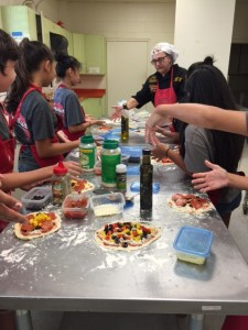 Albert Grande sharing his pizza passion with young Hawaiians.