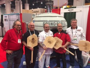 That's pizza champion Leo Spizzirri in the center, following one of his five demo's, flanked by a few of his fans.