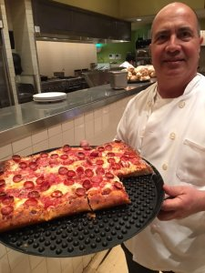John with one of his Sicilian pizzas at Metro.