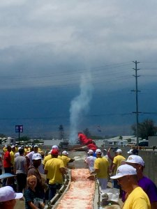Baking and patching over a mile long track-- hey, this ain't your grandma's pizza...