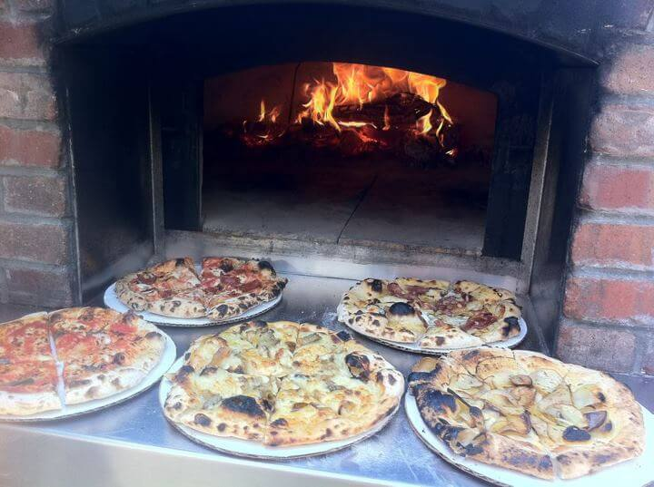 5 pizzas on oven hearth