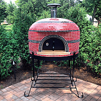 Napolino wood fired pizza oven by Forno Bravo shown on black steel stand with door & thermometer. Black and Red standard tile finish.