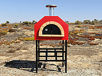 Strada60 wood fired pizza oven by Forno Bravo shown with red powder coat on stand in Northern California.