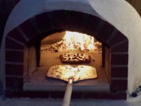 Giardino Pizza Oven with Pizza and Fire
