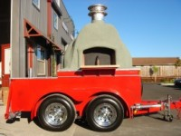 Mobile pizza oven on trailer.