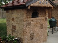 Casa pizza oven with stone veneer slate roof and extended throat