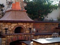 Casa modular pizza oven kit with stone veneer and oriental style roof