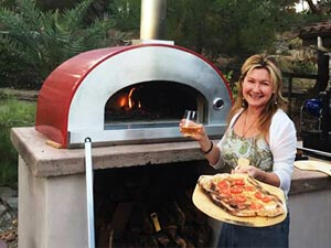 Bella stainless steel wood fired pizza oven on countertop