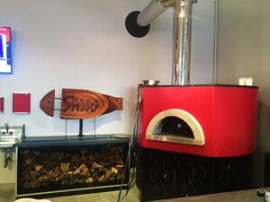 red Professionale commercial pizza oven in restaurant