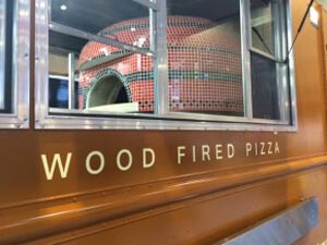 Wood fired commercial oven built inside of a bus