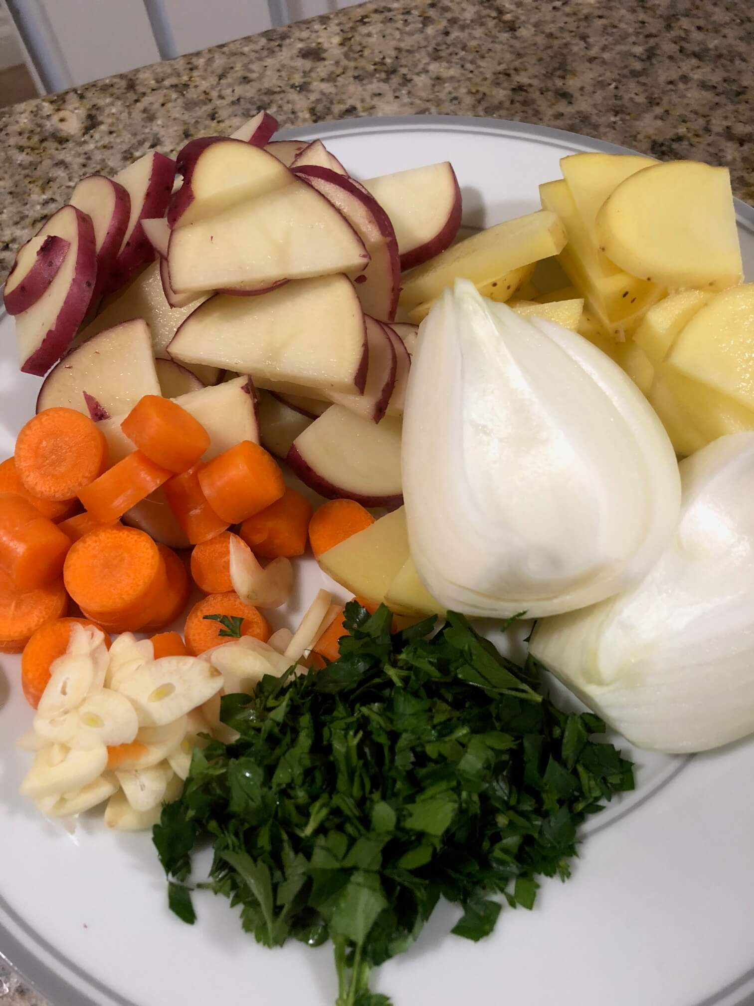 Close up of chunk-cut vegetables on a white plate