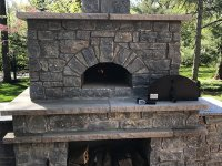 Stone Enclosed Casa pizza oven and wood storage
