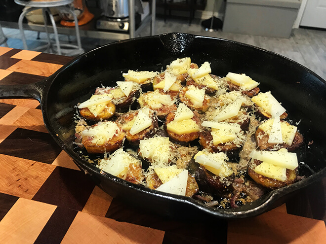 Figs in cast iron pan covered with cheese