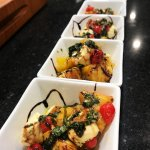 Wood Fired Peach Caprese Salad in white square bowls