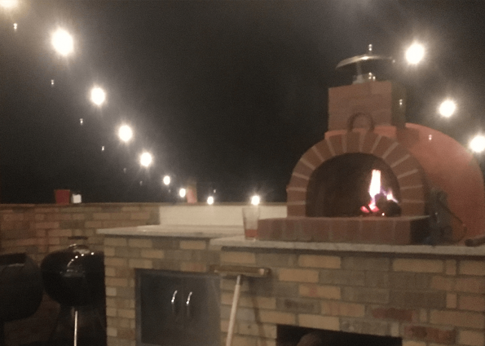 nu-giardino70-customer-night_view_with_fire_counter_and_patio