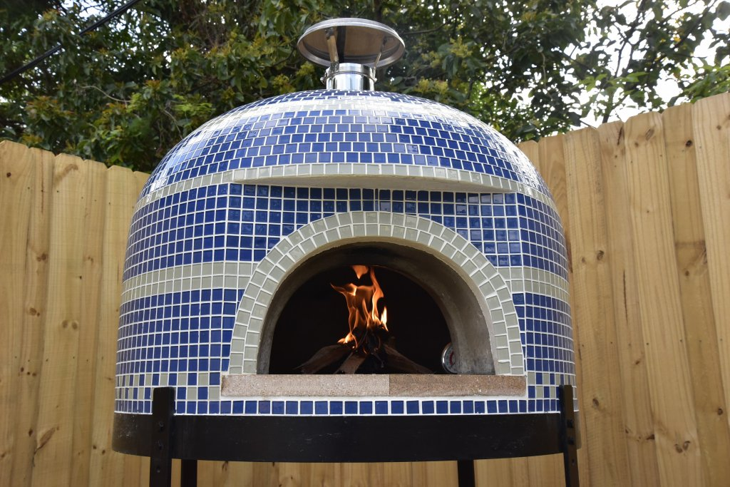 blue and white tile Napolino with small fire