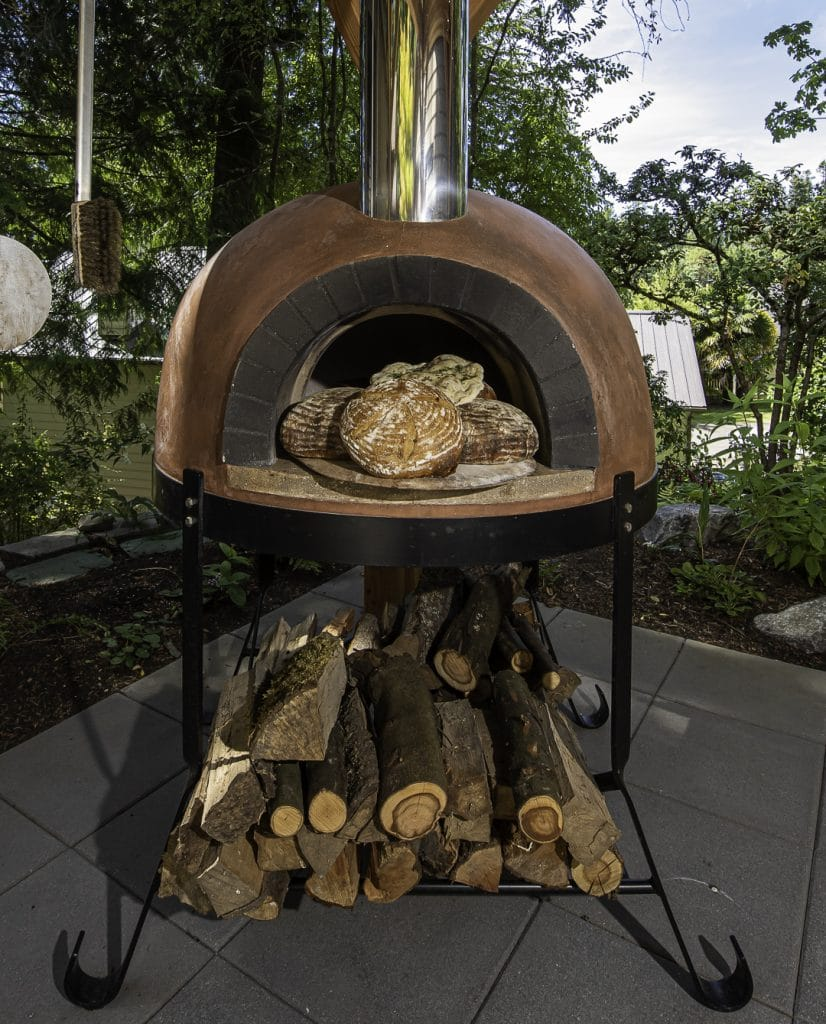 Oven with bread and wood