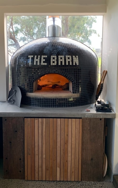 black tiled Casa100 pizza oven with fire