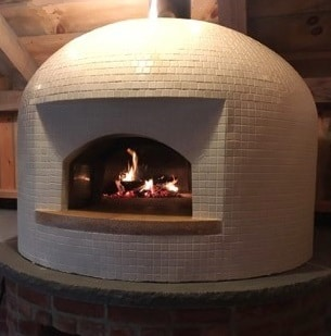 white domed pizza oven with fire